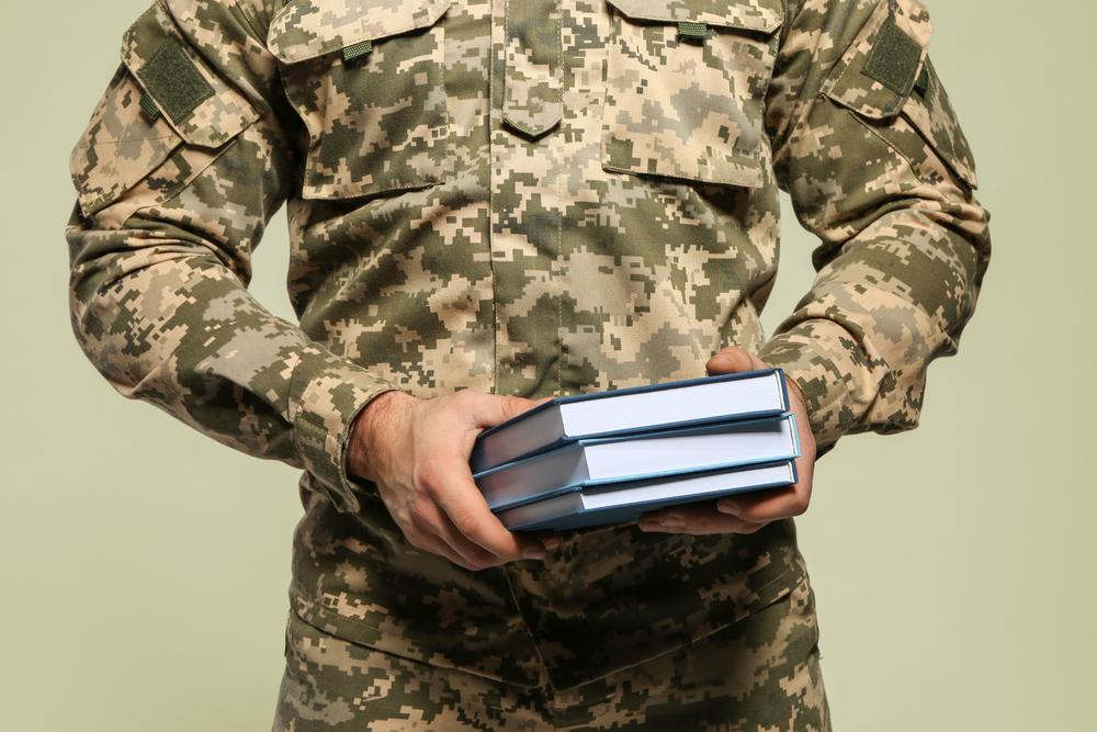 Student veteran holding textbooks