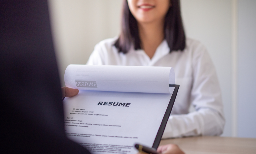 Business people reading resume documents of job applicants.